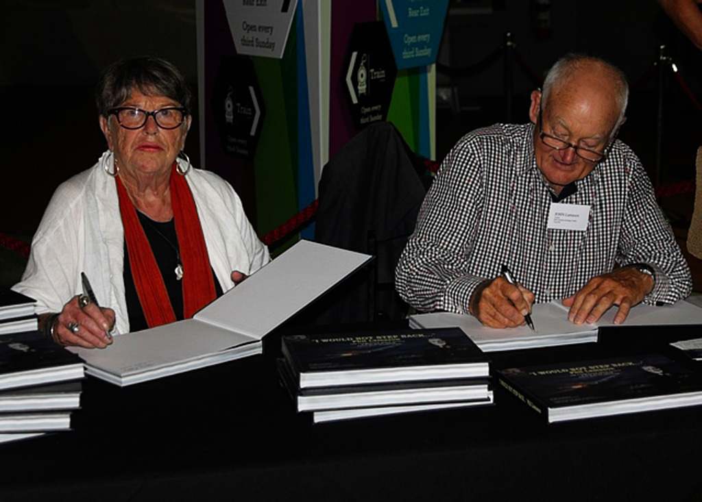 Writer Hilary Pedersen and John Lamason (Son of Phil Lamason) signing books at the MOTAT book launch, Auckland, March 2018.