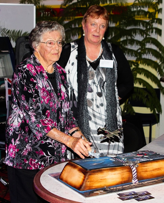 Mrs Ailsa Cullen, widow of New Zealand's other 1944 Buchenwald airman survivor, Malcolm Cullen, with Glenys Scott at the Ceremonial cake-cutting, Dannevirke book launch, February 2018.